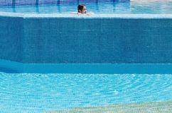 Little girl swimming in a pool Royalty Free Stock Photography