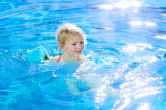Little girl swimming in the pool Stock Photo