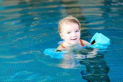Little girl swimming in the pool Royalty Free Stock Photography