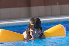 Little girl in a swimming pool Royalty Free Stock Photography