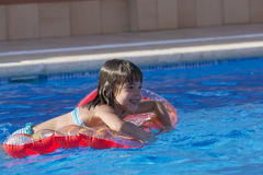 Little girl in a swimming pool Stock Photos