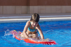 Little girl in a swimming pool Royalty Free Stock Images