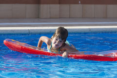Little girl in a swimming pool Royalty Free Stock Photo