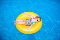 Little girl in swimming pool on inflatable ring Stock Photography