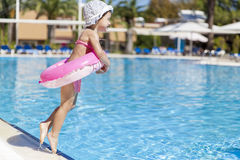 Little girl at swimming pool Royalty Free Stock Images