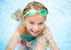 Little girl in swimming pool. Smiling little girl in swimming pool Stock Photos
