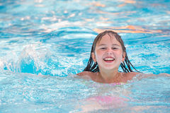 Little girl in swimming pool. Summer outdoor Stock Photo