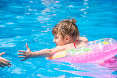 Little girl swimming in the pool Royalty Free Stock Photo
