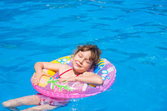 Little girl swimming in the pool Stock Photos