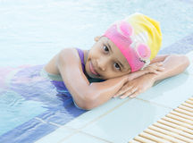 Little girl in swimming pool Royalty Free Stock Photography