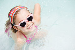 Little girl in swimming pool Royalty Free Stock Photo