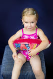 Little girl with swimming rubber Stock Photos