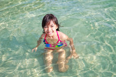 Little girl swimming in sea Stock Photography