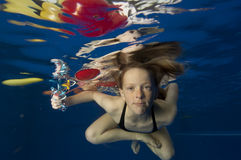 Little girl swimming underwater Royalty Free Stock Photo