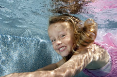 Little girl swimming underwater Stock Images