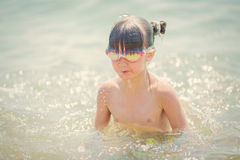 Little girl swims and dives to the sea Royalty Free Stock Photo
