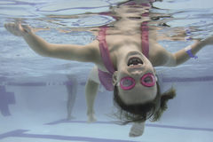 Little Girl Swims Under Water Stock Photos