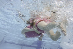Little Girl Swims Under Water 3 Stock Photography