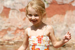 A Little Girl in a Swimsuit. This four-year-old pixie just loves showing off her new swimsuit down at the creek Stock Photos