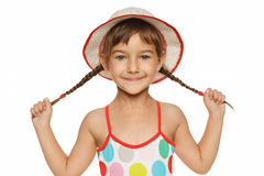 Little girl in swimsuit and hat Stock Photos