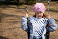 Little girl in the swing Royalty Free Stock Image