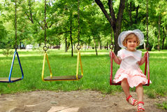 Little girl on swing. Happy little girl on swing royalty free stock photos