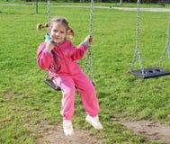 Little girl on swing Royalty Free Stock Image