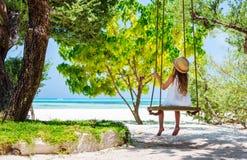 Little girl on a swing Stock Image