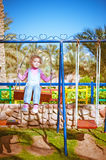 Little girl on swing in children's Royalty Free Stock Photo