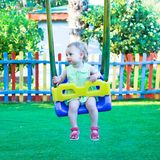 Little girl on the swing Royalty Free Stock Photos