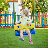 Little girl on the swing Royalty Free Stock Photography