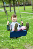 Little girl on swing Royalty Free Stock Photo