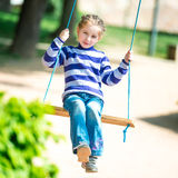 Little girl on swing Stock Photography