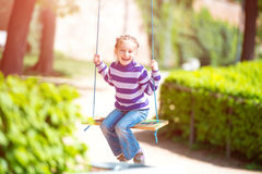 Little girl on swing Stock Images