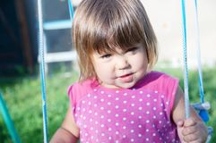 Little girl swing outdoor at summer, child playing. Activity stock images