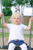Little girl on swing. In the park stock images