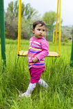 Little girl on the swing. In the park stock photos