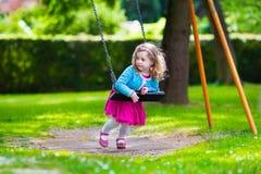 Little girl on a swing Stock Photos