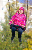 Little girl on swing Royalty Free Stock Photography