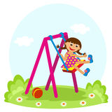 Little girl on the swing. In summer Royalty Free Stock Photo