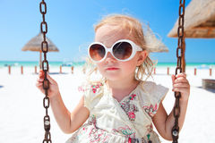 Little girl swinging Stock Image