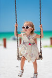 Little girl swinging Stock Photography
