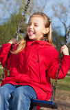 Little girl swinging. Cute happy little girl swinging Stock Image