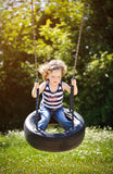 Little girl is swinging Royalty Free Stock Photography