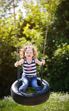 Little girl is swinging Stock Photography