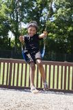 Little Girl Swinging At The Park Stock Image