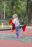 Little girl swinging Stock Photo
