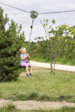Little girl swinging Royalty Free Stock Photo
