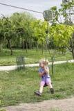 Little girl swinging Stock Images