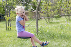 Little girl swinging Royalty Free Stock Images
